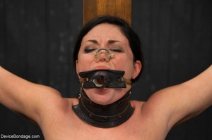 All-natural woman is bound in the most uncomfortable position as she takes the mistreatment well. - XXXonXXX - Pic 11