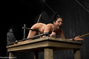 All-natural woman is bound in the most uncomfortable position as she takes the mistreatment well. - XXXonXXX - Pic 14