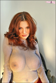 redhead babe showing her
