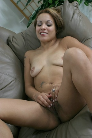 Tattooed babe spreads her bald pussy lips on the couch. - XXXonXXX - Pic 5