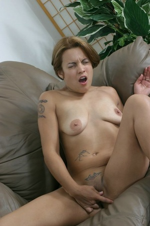 Tattooed babe spreads her bald pussy lips on the couch. - XXXonXXX - Pic 9