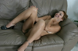 Tattooed babe spreads her bald pussy lips on the couch. - XXXonXXX - Pic 15