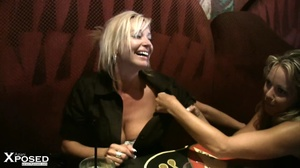 Busty blonde with gorgeous body in black blouse and multi colord skirt drinks punch with her hot friend before they show their humongous breasts in a bar. - XXXonXXX - Pic 7