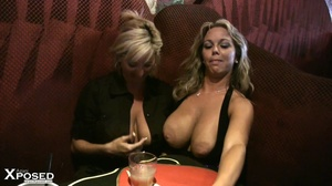 Busty blonde with gorgeous body in black blouse and multi colord skirt drinks punch with her hot friend before they show their humongous breasts in a bar. - XXXonXXX - Pic 10