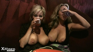 Busty blonde with gorgeous body in black blouse and multi colord skirt drinks punch with her hot friend before they show their humongous breasts in a bar. - XXXonXXX - Pic 11