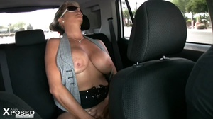Blonde hottie bares her humongous boobs and sweet crack as she spreads her legs wide in a car wearing her gray blouse and black skirt. - XXXonXXX - Pic 15