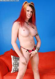 foxy redhead t-girl showing