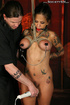 Tattooed busty brunette gagged, bound, tits tied, clipped and pounded