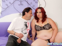 Chubby redhead in black lingerie blows dick and spreads - Picture 1