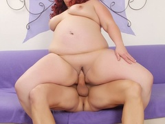 Chubby redhead in black lingerie blows dick and spreads - Picture 9