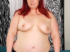 Big redhead in sexy black lingerie fingers cunt, sucks - Picture 3