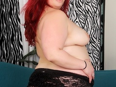 Big redhead in sexy black lingerie fingers cunt, sucks - Picture 5