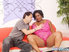 Chubby ebony in pink dress sucks cock, gives tits job - Picture 1