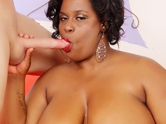 Chubby ebony in pink dress sucks cock, gives tits job - Picture 2
