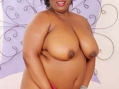 Tattooed big ebony in pink dress flaunts big tits, rubs - Picture 5