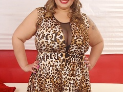 Tattooed brunette in leopard spot dress and black - Picture 1