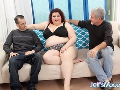 Chubby busty babe in black lingerie sucks two cocks and - Picture 1