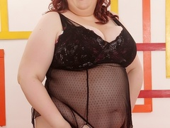 Sexy chubby redhead in black lingerie and spotted bra - Picture 1