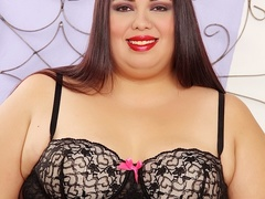 Big brunette with pierced tits in black negligee and - Picture 2