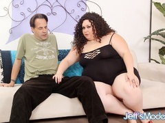 Curly hair chubby brunette in black rubs cunt and sucks - Picture 1