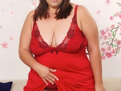 Sweet brunette in red dress and black panties drills - Picture 2