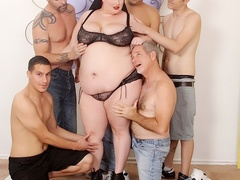 Cute chubby redhead in black lingerie takes five cocks - Picture 1