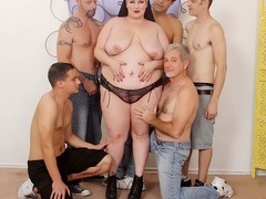 Cute chubby redhead in black lingerie takes five cocks - Picture 2