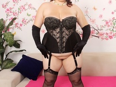 Big brunette in black corset and stockings sucks cock as - Picture 1