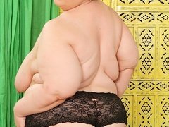 Big chubby brunette in blue and black lingerie plays - Picture 7