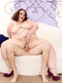 Enticing chubby brunette in white takes - Picture 10