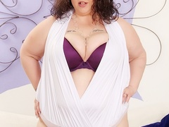 Chubby brunette in sexy white outfit flaunts big tits - Picture 1