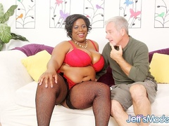 Big boobs ebony in red lingerie and black stockings - Picture 1