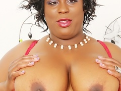 Horny busty ebony in black dress and red lingerie rubs - Picture 4