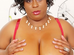 Horny busty ebony in black dress and red lingerie rubs - Picture 6
