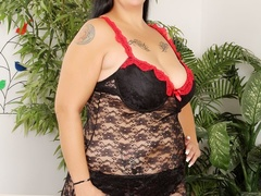Hot tattooed brunette in red and black negligee sucks - Picture 1