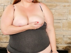 Chubby brunette in dark top and dotted panties shows - Picture 3