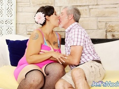 Tattooed brunette in sexy pink dress blows dick cock, - Picture 2