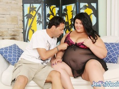 Big chubby brunette in black negligee and purple panties - Picture 1