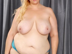 Busty big blonde in green dress and blue panties flaunts - Picture 6