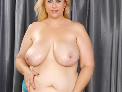 Busty big blonde in green dress and blue panties flaunts - Picture 9