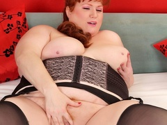Cherry redhead in black corset and stockings rubs cunt - Picture 10