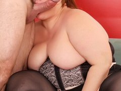 Cherry redhead in black corset and stockings rubs cunt - Picture 12