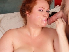 Cherry redhead in black corset and stockings rubs cunt - Picture 14