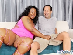 Busty chubby ebony in pink sucks cock, gives tits job - Picture 1