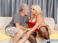 Chubby blonde in red negligee measures cock then sucks - Picture 1