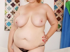 Busty brunette in black with brown spots lingerie rubs - Picture 3