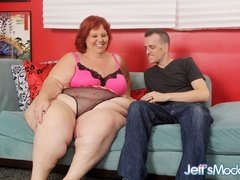 Big redhead in pink and black lingerie works cock with - Picture 1