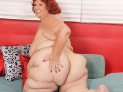 Hot and big redhead in black and pink lingerie shows fat - Picture 9