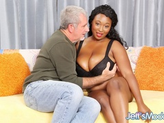Big tits ebony in black bra works cock with tits, mouth - Picture 1