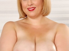 Busty chubby blonde in black negligee flaunts tits and - Picture 5